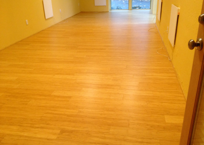 Drop and Lock pre-finished Bamboo flooring as a floating floor installed in office area with Bamboo base shoe baseboard