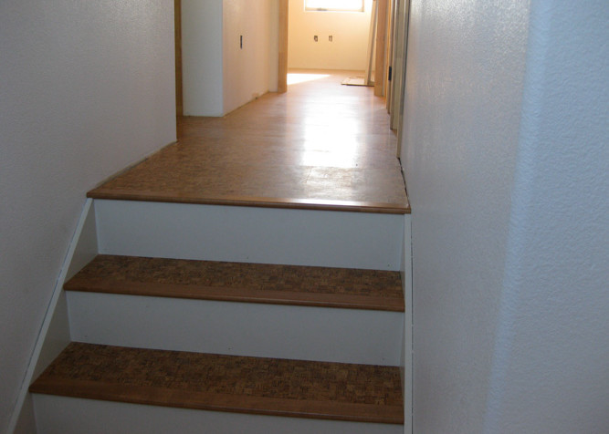 Pre-finished Cork Flooring on stairs with painted risers
