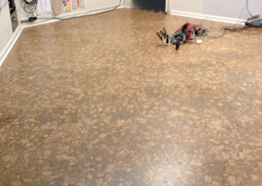 Pre-finished cork flooring installed as a floating floor installation with new baseboard in sound studio at KSCO new talk radio