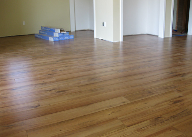 Laminate Plank Flooring as a floating installation in family room