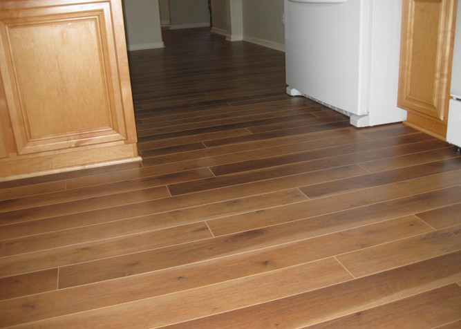Laminate Plank Flooring as a floating installation with new baseboards