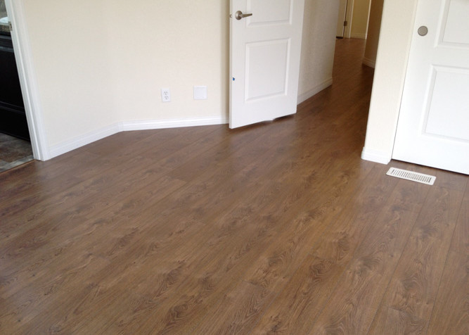 Laminate Plank flooring install as a floating floor in a manufactured home with new baseboards