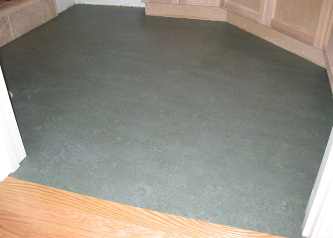 Marmoleum Sheet Flooring as a flat lay installation with new baseboards