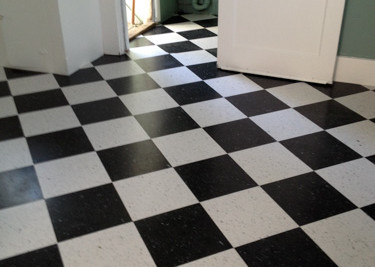 """VCT Tile 12"""" x 12"""" flooring (vinyl composition tile) installed as a diagonal checkboards style in kitchen/utility room"""
