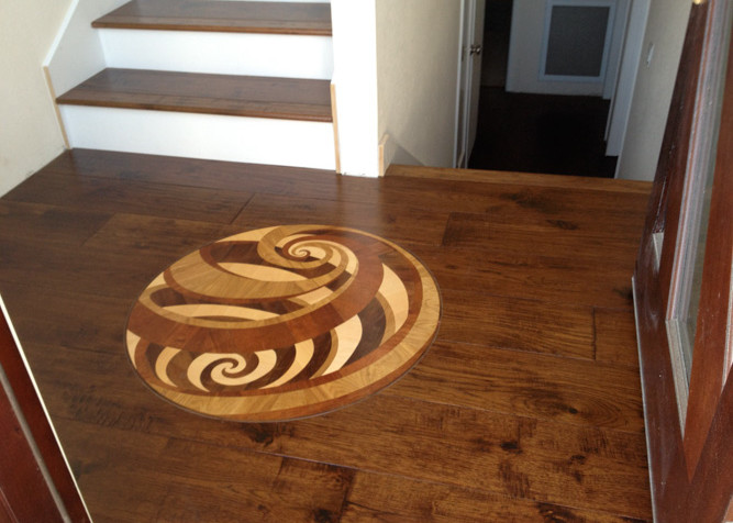 Engineered Pre-finished Wood Flooring with Medallion Design installed in entry