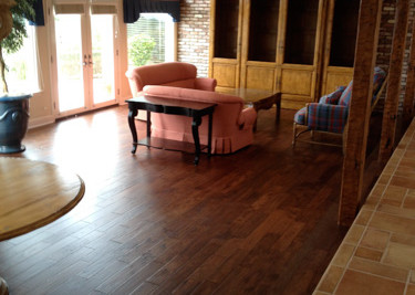 """Pre-finished engineered wood flooring,Pre-finished 5"""" width random length engineered wood flooring installed as a nail down installation in the living room"""