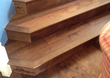 """Pre-finished 5"""" width engineered wood flooring installed on steps"""