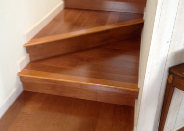 """Pre-finished 3 1/2"""" width engineered wood flooring installed as a nail down on floors and glued-nailed down staircase with new baseboards"""