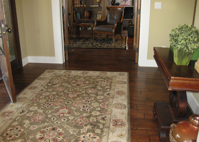 """Solid 3/4"""" x 5"""" Pre-finished random length wood flooring installed as a nail down floor installation with new baseboards"""