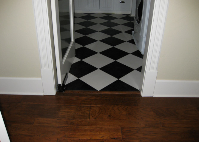 Engineered pre-finished random width, floating floor install, with VCT Tile