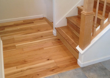 Wire brushed-oiled pre-finished T&G engineered wood flooring installed as a floating floor installation with pre-finished flooring on risers