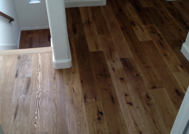 Pre-finished T&G engineered wood flooring installed as a floating floor installation
