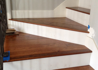Hickory pre-finished T&G engineered random width flooring with printed riser on stairway