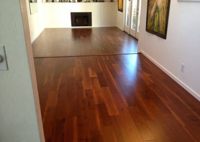 Pre-finished Black Walnut T&G engineered wood flooring as floating installed with step in kitchen area and family room