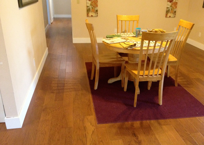 Engineered T&G Hickory pre-finished wood flooring as nail down installation with new baseboards