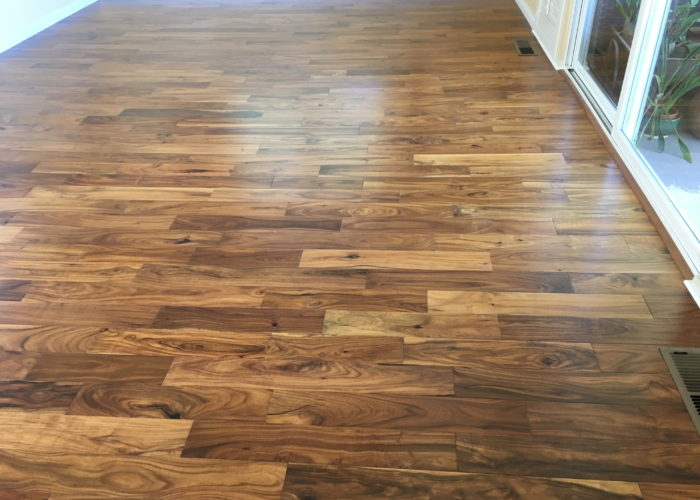 T&G Pre-finished wood flooring as a floating install in living room area.
