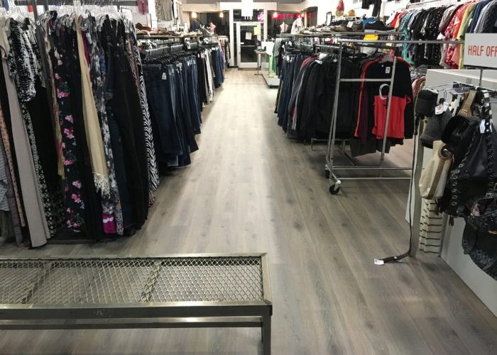 Crossroads Trading Company Laminate Plank flooring as a floating floor installation Show room