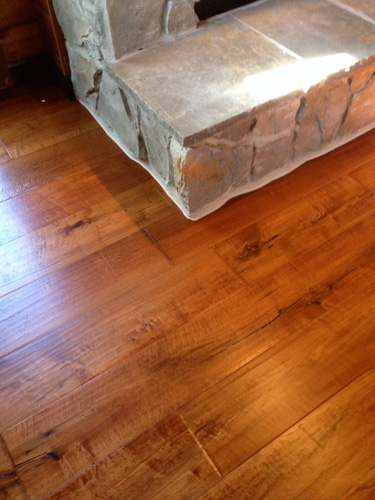 Pre Finished Engineered Plank Flooring Installed As A Nail Down Installation Around Rock Fireplace With